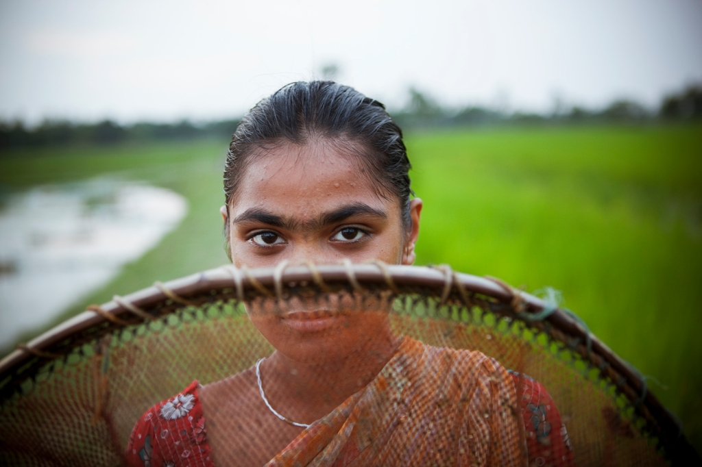 Indian girl with fishing net.